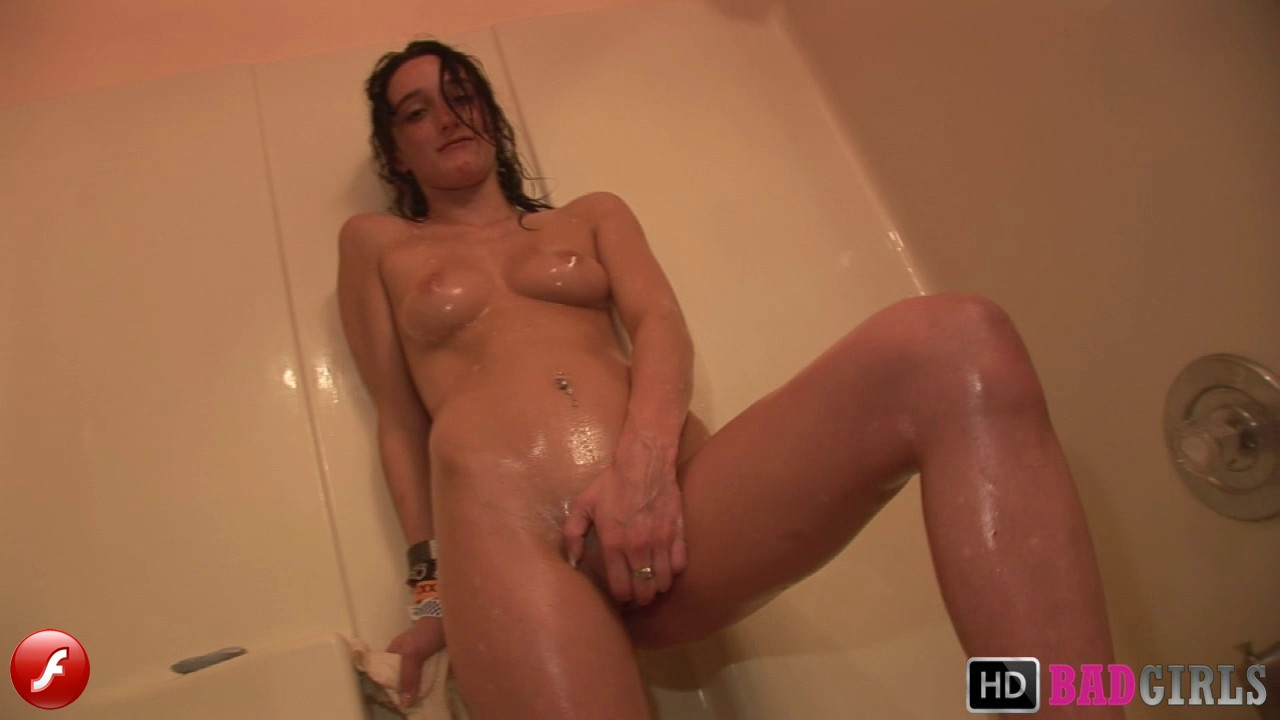 Watch as a drunk college girl teases her wet pussy in the shower as she answers questions about her sex life